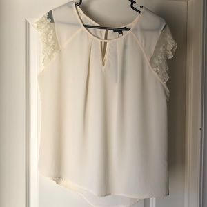 Cream blouse with lace sleeves and keyhole neck
